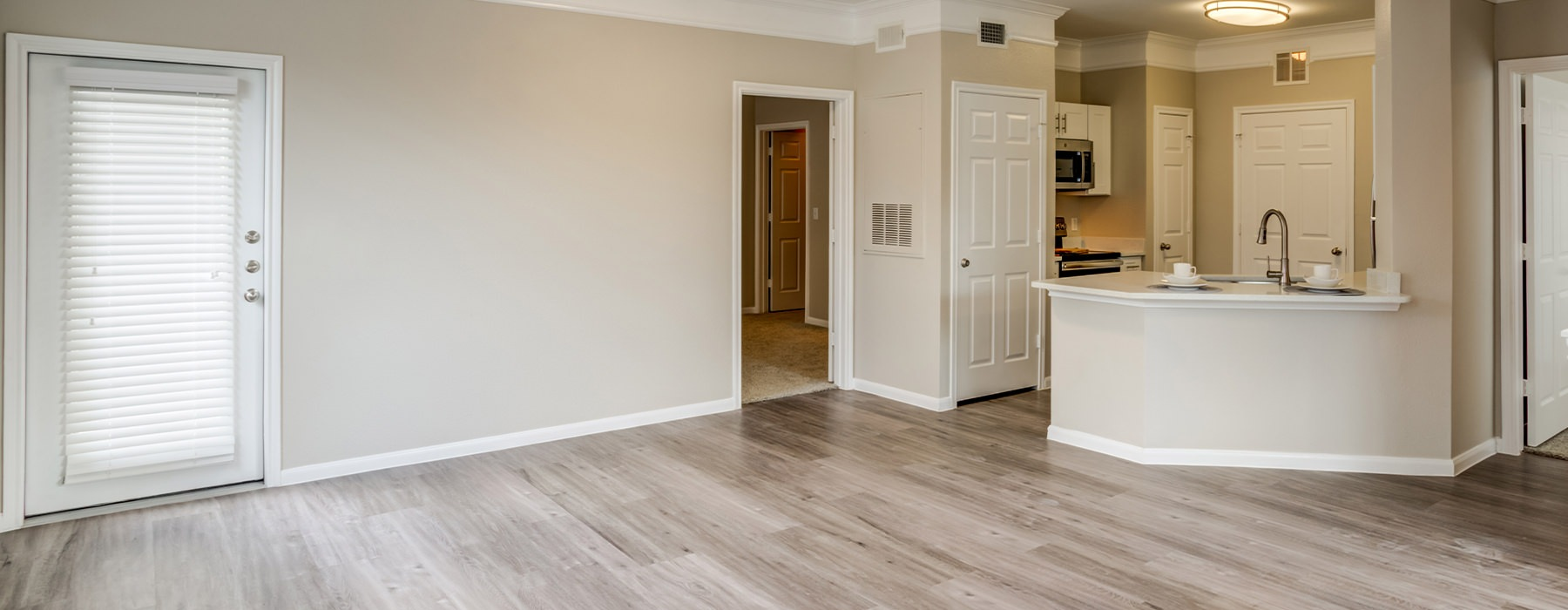 Spacious living space with open floor plan and access to the kitchen.