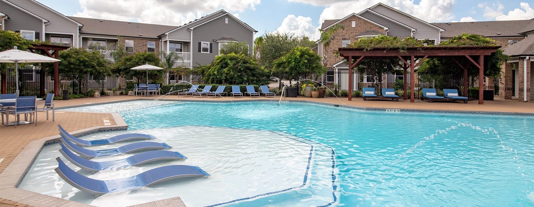 Spacious pool with sundeck and multiple cabanas